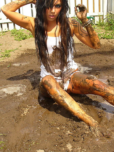 Watch as Deja rolls around in the mud in her bra and panties